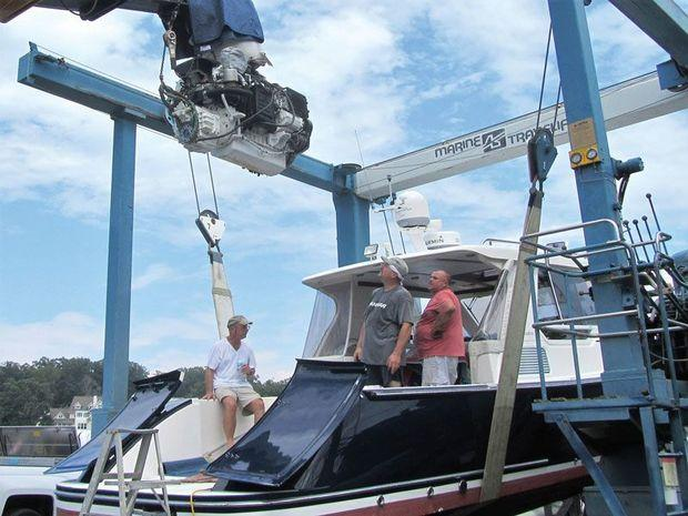 A Volvo Penta D6-4351A, 435-hp diesel being removed from a True North 34 by the crew from Hartge Yacht Yard in Galesville, MD.