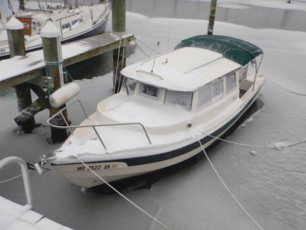 Snowed-over decks mean that the boat must take care of itself until a thaw.