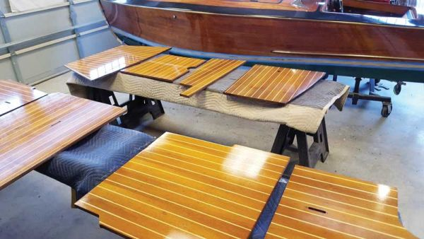 Spring varnish work covers every available surface in Classic Watercraft's shop in Annapolis, MD.
