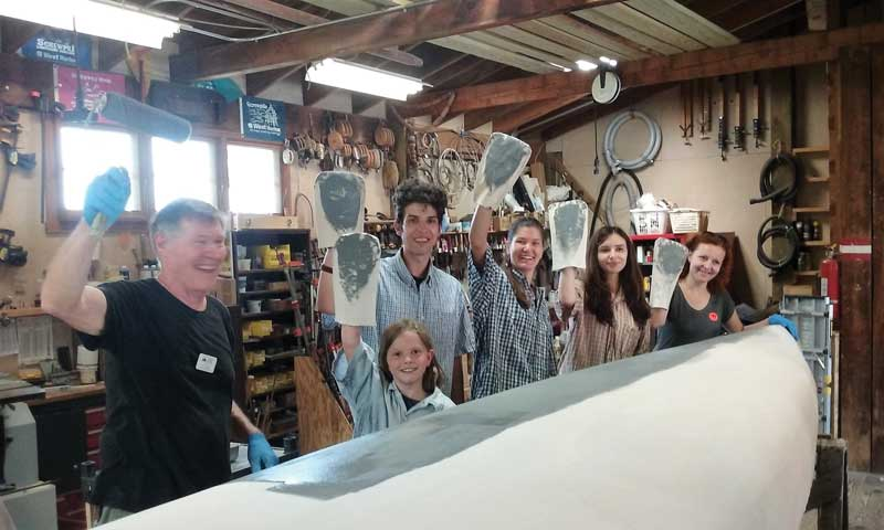 Tony Pettit, Patuxent Small Craft Guild volunteer, with visiting students from Bosnia in the shop at Solomons, MD.