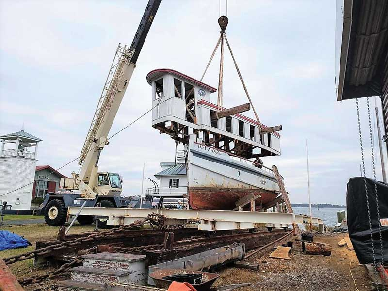 The cabin house of 1912 river tug Delaware is removed from her hull by crane at the Chesapeake Bay Maritime Museum in St. Michaels, MD.