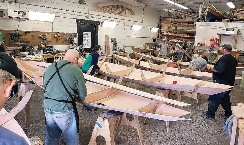 Novice boat builders completing their dories at Chesapeake Light Craft in Annapolis MD.