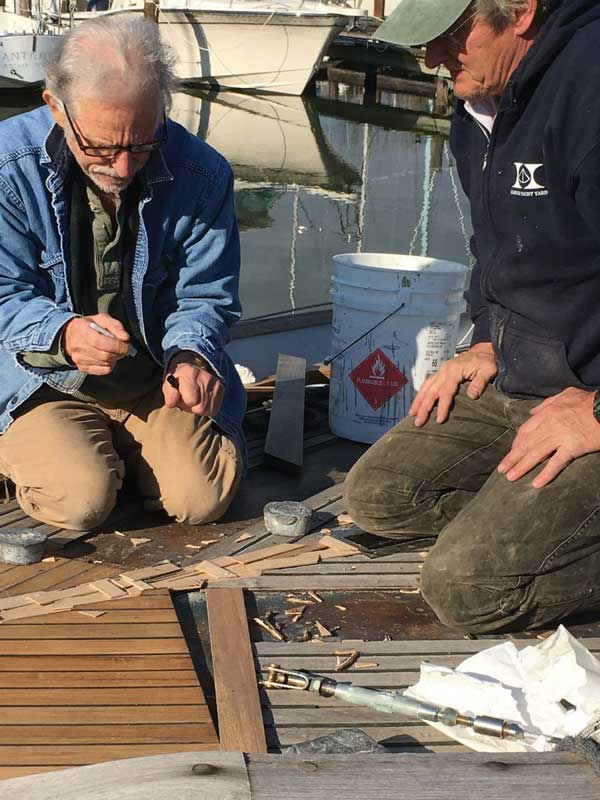 Allen Cady (L) and Peter Bell restoring a teak deck at Hartge Yacht Yard in Galesville, MD.