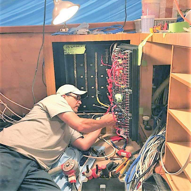 Rick Kendall rewiring the main distribution panel on a 74-foot Spencer Sport Fisherman at Worton Creek Marina in Chestertown, MD.