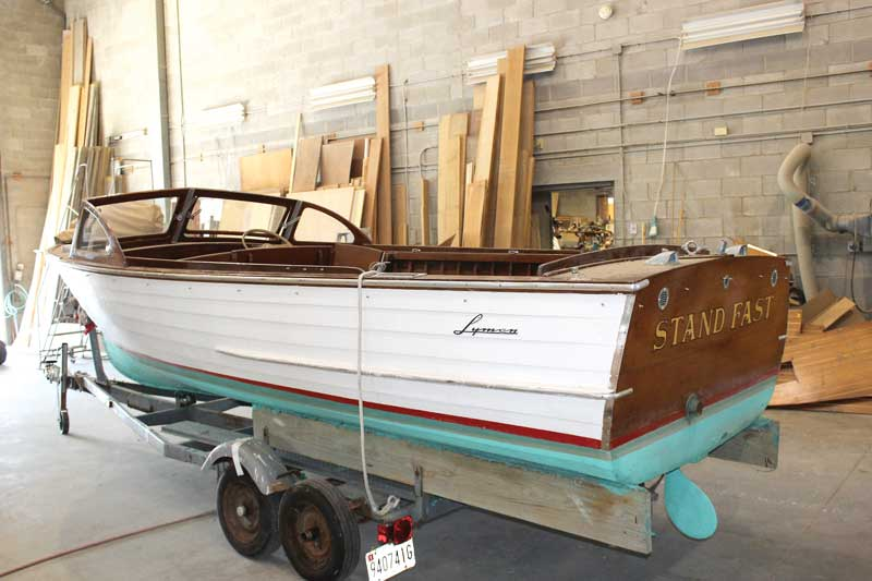 Stand Fast, a 1959 19-foot Lyman inboard utility boat in the shop at Phipps Boat Works in Deale, MD. Photo by Rick Franke