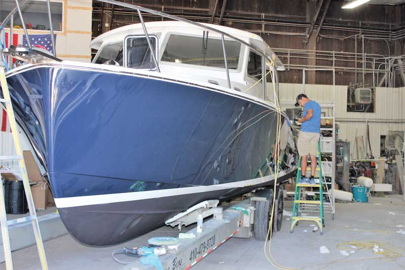 Final details before launching on the fourth Eastport 32 to be built by Mathews Boat Works in Denton, MD. Photo by Rick Franke