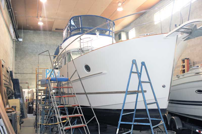 Worth The Wait, a Beneteau 44 trawler, having her varnish work redone at Phipps Boat Works in Deale, MD. Photo by Rick Franke.