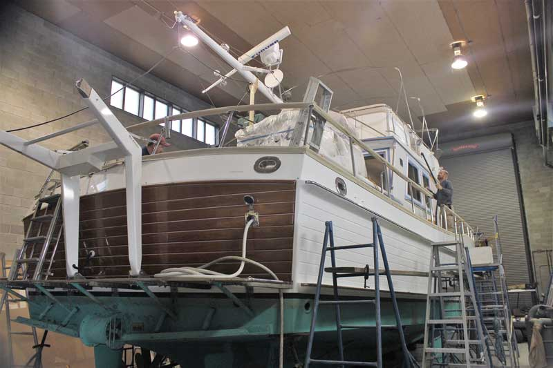 A grand Banks 60 in the shop for woodwork repairs and varnish work at Phipps Boat Works in Deale, MD. Photo by Rick Franke