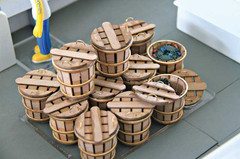The workboat models can be accessorized with miniature crab baskets, crab traps, nets, and boat hooks.