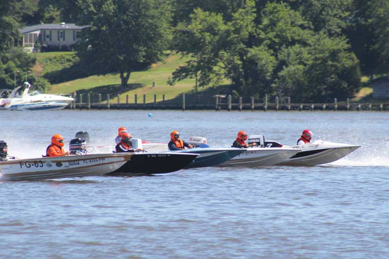 Classic boats race just off the Leonardtown Wharf . Photo by John Nepini, Southern Maryland Boat Club