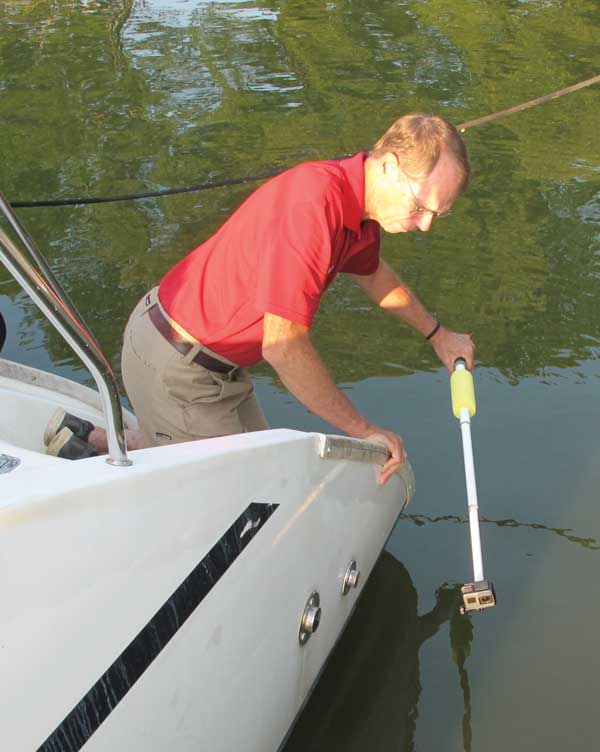 An underwater camera mounted on a boat hook can you allow you to check for damage or marine growth while the boat is still in the water.