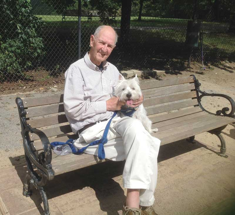 Wally Stone rests for a moment with his dog while at Quiet Waters Park. Photo courtesy of Cindy Murphy