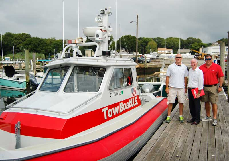 The USCG aims to improve 911 system for boaters. Capt. Jeff Dziedzic, TowBoatUS Mystic, Connecticut; Rep. Joe Courtney (D-Conn.); and Capt. Keith Turgeon, TowBoatUS Mystic. Photo courtesy TowBoatUS Mystic)
