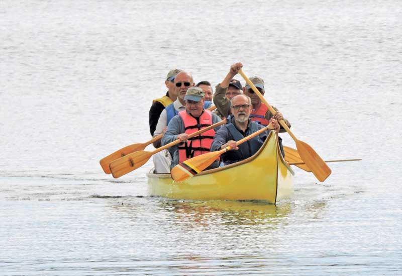 Members of the Patuxent Small Craft Guild paddle the newly relaunched camp canoe in Solomons, MD.