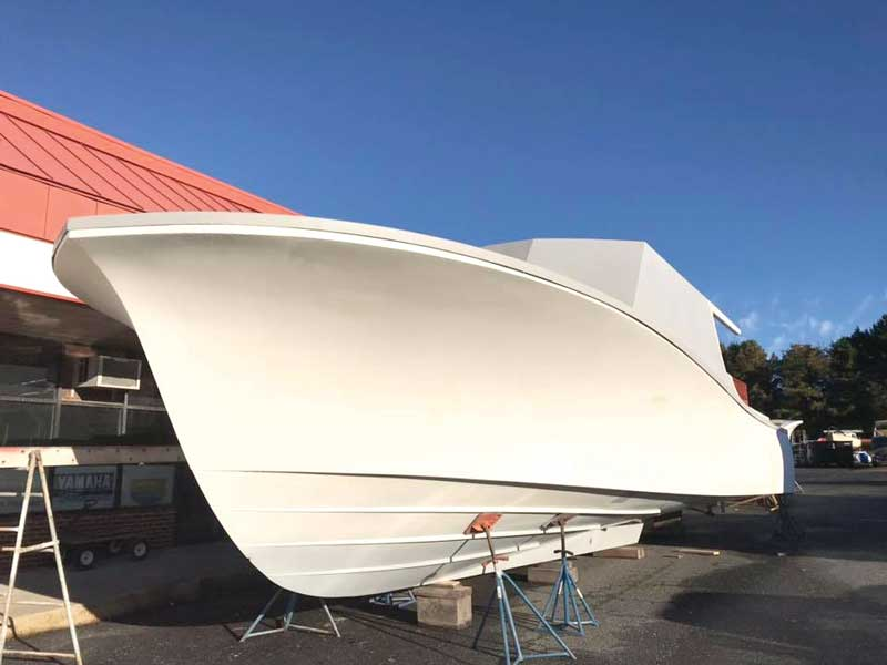 The new custom CY46 moves out of the molding shop for completion of her interior at Composite Yacht in Trappe, MD.