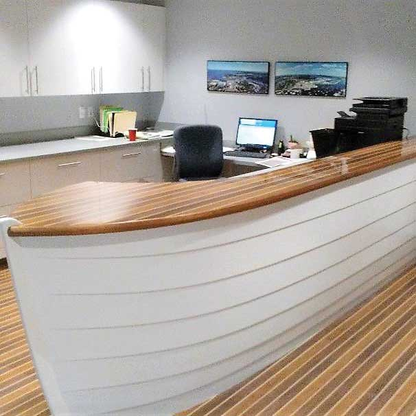 The boat-shaped reception desk at the Annapolis Boat Shows' new office at 110 Compromise Street was built by Chesapeake Light Craft in Annapolis, MD. Photo by Rick Franke