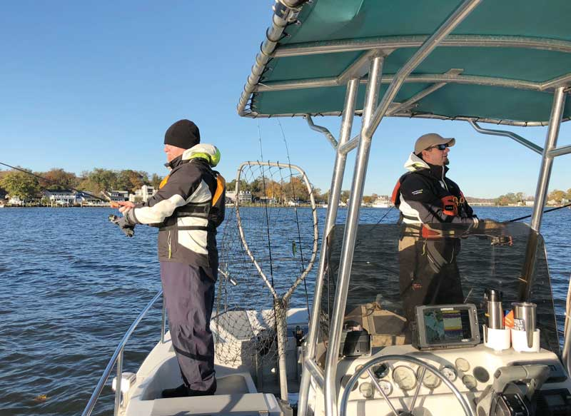 PropTalk staffers Chris Charbonneau and Zach Ditmars wearing vest-style PFDs during the Fish for a Cure tournament in November.