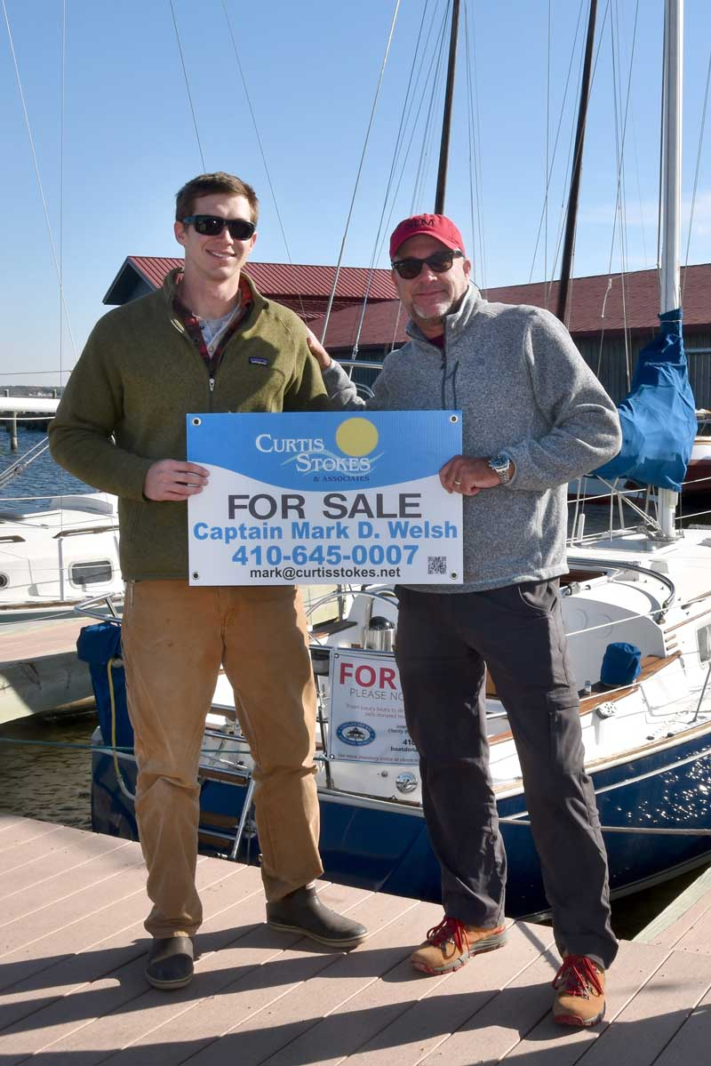 The Chesapeake Bay Maritime Museum in St. Michaels, Md. has recently announced the formation of a new, preferred partnership with Curtis Stokes & Associates, represented here by broker Mark Welsh, left, standing with CBMM Charity Boat Donation Program Director Taylor Williams