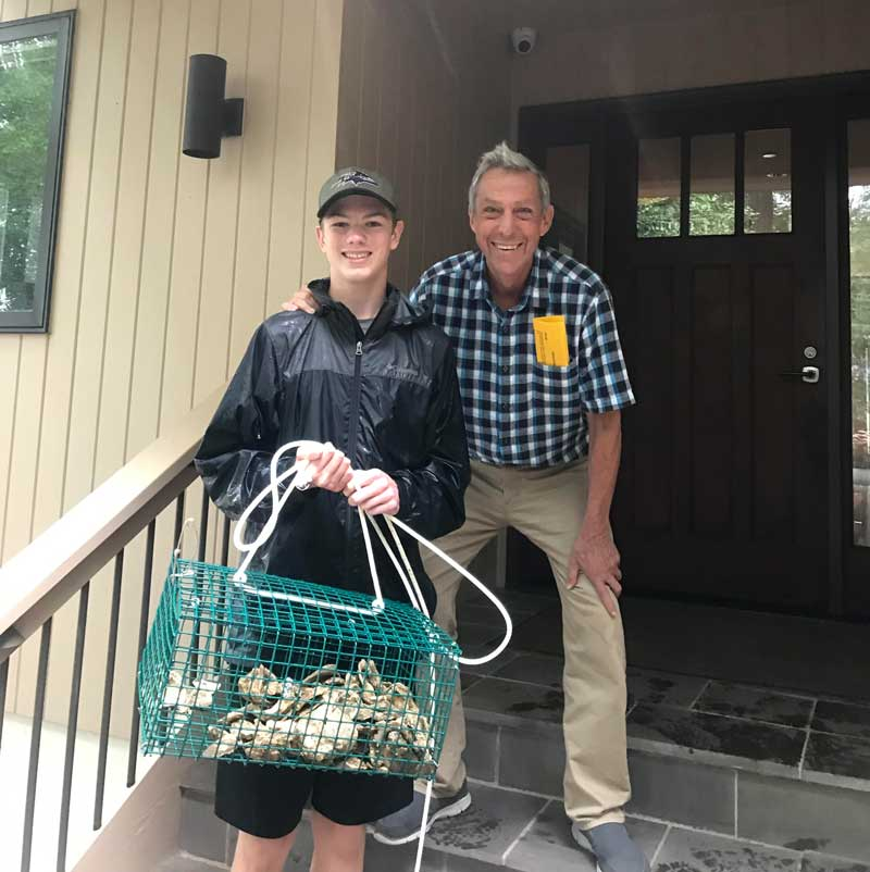 Boy Scout Josh Newmier was able to recruit 23 new property owners to the oyster gardening program, including Dr. Tony Calabro (right). Photo courtesy ShoreRivers