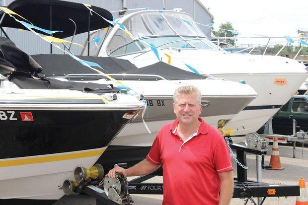 Hawk Ennis of Hawk's Yachts in Edgewater, MD, with two used boats he bought from a dealer in Ocean City to help replace his depleted inventory. Photo by Rick Franke