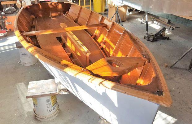 Victoria, a 1960s Penguin class dinghy, hull # 6129, completely rebuilt and restored at Classic Watercraft Restoration in Annapolis, MD.