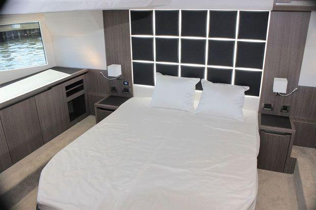 The midship, full beam, owners state room with a centerline queen size bed.