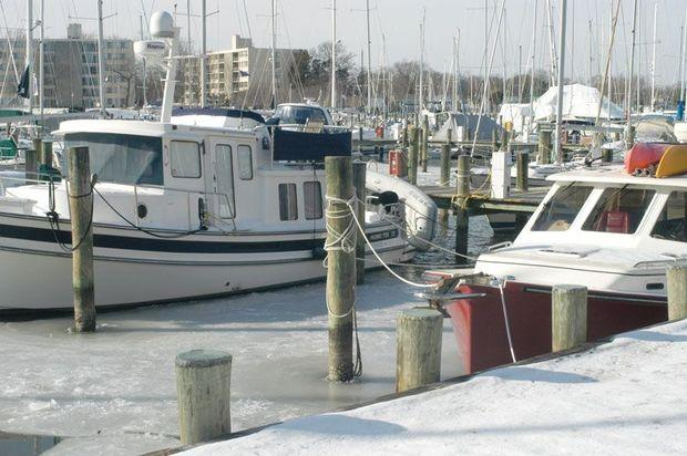 Whether or not you leave your boat in the water for the winter depends on your boat and your insurance policy. Check your policy to be sure you're covered.