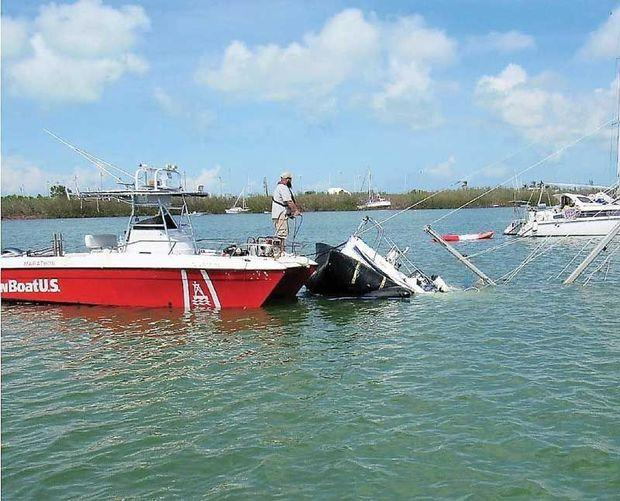 The BoatUS catastrophe team at work clearing sunken boats from Boot Key Harbor, FL. Photo by BoatUS