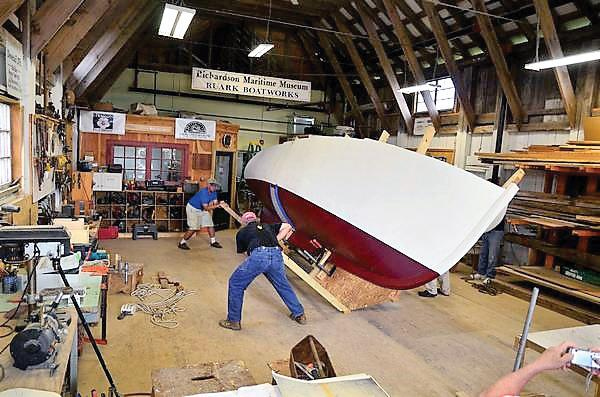 Turning the completed hull of Miss Polly in the Ruark Boatworks shop at Richardson Maritime Museum in Cambridge, MD.