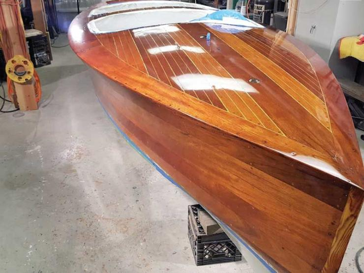 Gin Mill, a 22 foot Hacker Craft, sports newly varnished topsides and deck at Classic Water Craft Restoration in Annapolis, MD.