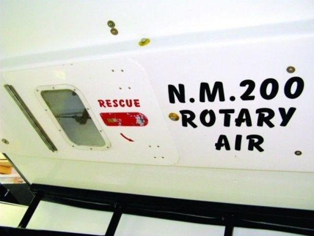 "The escape hatch below the cockpit and between the sponsons on the Special. The number tells rescuers the identity of the boat. ""ROTARY"" identifies the type of latch on the drivers harness and ""AIR"" tells them the driver has an air bottle with approximately 30 minutes of air."